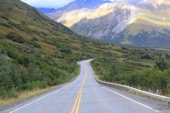 Long highway winding its way down hill Royalty Free Stock Photo