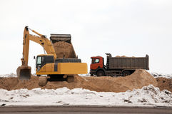 Highway construction. Construction work on a highway, device of a layer of sand Royalty Free Stock Photography