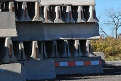Highway Construction Barriers. Rows of concrete road construction barricades royalty free stock image