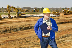 Highway Construction Foreman. Horizontal shot of highway construction foreman holding clipboard and looking to side stock photography