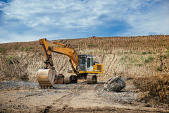 Highway construction site - engineer working with excavator and loading gravel, soil and earth Stock Photo