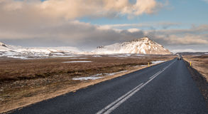 Highway countryside straight road. With car and mountains covered in snow at  Snæfellsnes Peninsula in Iceland Stock Photo