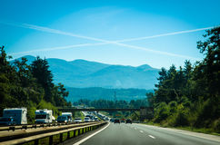 Highway and cross sign in sky. Cross sign from planes in blue sky above highway Royalty Free Stock Image