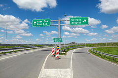 Highway crossroad in Serbia. New highway crossroad in Vojvodina, Serbia known as corridor 10 with sign for Belgrade and Novi Sad Stock Images
