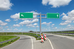 Highway crossroad and signs Royalty Free Stock Photo