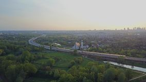 Highway curve and Warsaw skyline in the evening, Poland stock video footage