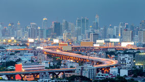Highway curved and city downtown background Royalty Free Stock Images