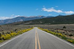 Highway curving into the distance toward a mountain range stock photos