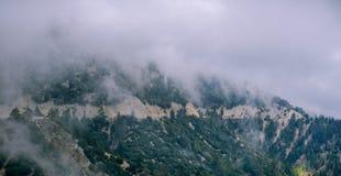 A highway cuts through a california mountain Stock Photos