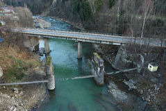 Highway and damaged pedestrian suspension bridge across mountain. River (view from above) in Yaremche, Ukraine Stock Images