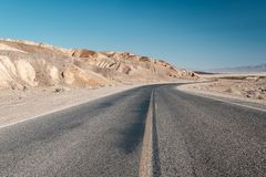 Highway in Death Valley National Park, California. Open highway in Death Valley National Park, California, USA Stock Photography