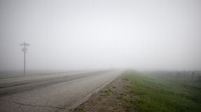 Highway in Dense Fog Royalty Free Stock Images