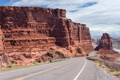 Highway descending to Lake Powell and Colorado River in Glen Canyon National Recreation Area Stock Photography
