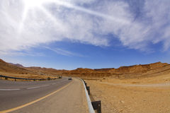 The highway in desert Royalty Free Stock Photos