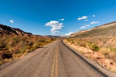 Highway through desert Stock Images
