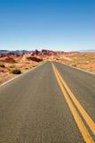 Highway through desert Royalty Free Stock Photo