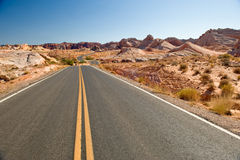 Highway through desert Stock Photos