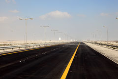 Highway in the desert of Bahrian Stock Photo