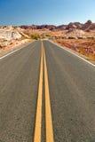 Highway in desert landscape Royalty Free Stock Photos