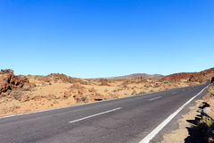 Highway in desert landscape with clear blue sky Royalty Free Stock Photo
