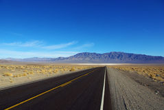Highway through the desert, Nevada Royalty Free Stock Photography