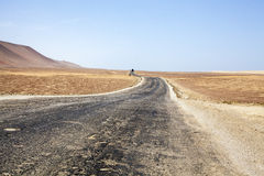 Highway through the desert next to the ocean in National Park Paracas in Ica, Peru Stock Photos