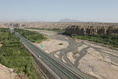 Highway through desert. Wide view of the highway in Xinjiang Province, China Stock Images