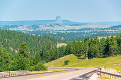 Highway and Devils Tower Royalty Free Stock Photo