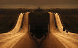 Highway of Dreams. Artistic, symmetrical image of a dream-like highway in sepia tones royalty free stock photos
