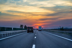 Highway driving at sunset. Driving at sunset on the highway to the Black Sea in Romania Royalty Free Stock Images