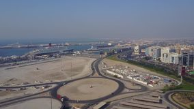 Highway on Dubai. Aerial view of The World Islands in Dubai. The islands were intended to be developed with hotel. Complexes and luxury villas, like The Palm is stock video