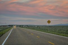 Highway at dusk in Colorado Stock Photography