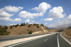Highway. Empty multi-lane highway and cloudscape Royalty Free Stock Photo