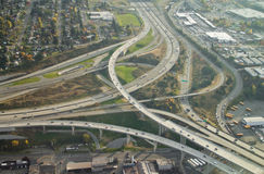 Highway Ending into Larger Highway. SR16 ends at I-5 in Tacoma, WA - aerial view Royalty Free Stock Photos