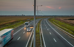 Highway by evening Stock Photos