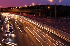 Highway at evening Stock Photos