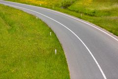 A highway exit lane. With green grass on the sides royalty free stock photos