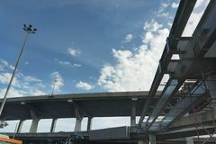 Highway express way overpass underconstruction across the cross road in thai city on blue sky back ground. Highway express way overpass underconstruction across Stock Photography
