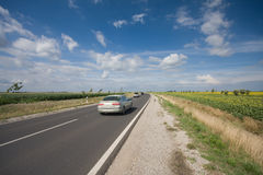 Highway with a fast car Stock Images
