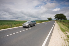 Highway with a fast car Royalty Free Stock Photo
