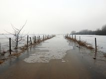 Highway in flood and winter fields, Lithuania Stock Photography