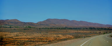 Highway through Flinders Range. Scenic view of outback highway with Flinders mountain range in background, Southern Australia stock photography