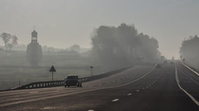 Highway in fog Royalty Free Stock Images