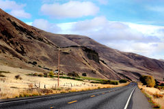 Highway at Foot of Hills Royalty Free Stock Photos