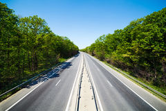 Highway through forest Royalty Free Stock Images