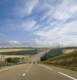Highway in France. A view of a beautiful long highway in France royalty free stock photo