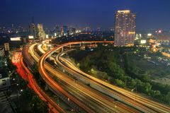 The highway is glowing. The density of vehicles on the highway creates a continuous lamp royalty free stock photography