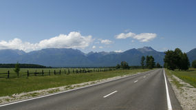 The highway going into the distance beyond the horizon. Stock Photo