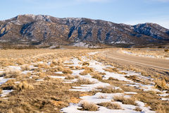 Highway 93 Great Basin HWY Cuts into Nevada Mountain Landscape Stock Photos