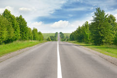 Highway among green fields Royalty Free Stock Images